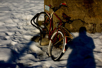 "Bicycle with my shadow, on the side of the old ""Vestbanen"" building, Oslo, Norway"